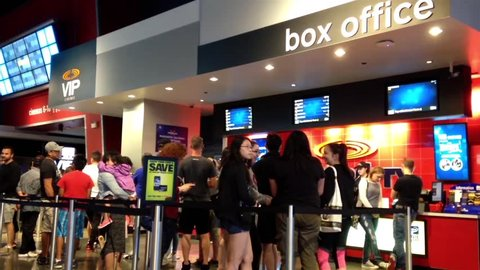 Coquitlam, BC, Canada - August 01, 2015 : People line up for buying movie ticket at cinema