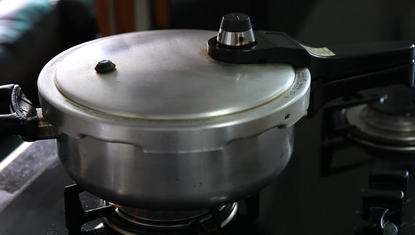 A pot of boiling water on the stove rapid boil with steam for Aroma cuisine bolton