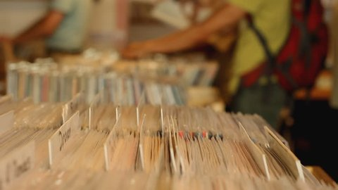 Customers browsing through vintage records in records store