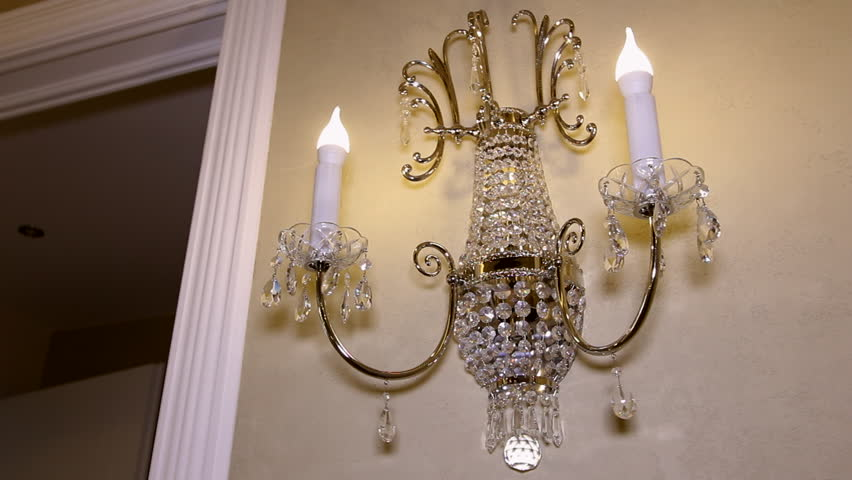Chandelier In The Form Of Candles On The Wall View Showcase Of Modern Elegant Luxury