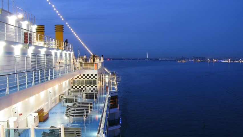 Cruise liner leaves Saint Petersburg at night, view from ship deck, time lapse