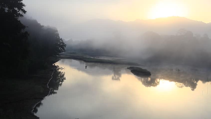 Fog rising from a river near Kaziranga National Park, Assam