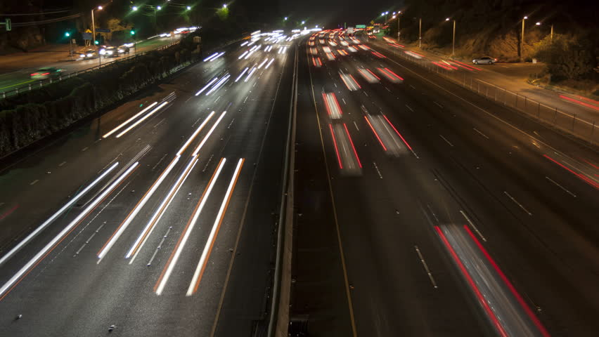 4K Time lapse zoom out night motion light trails on a busy Los Angeles freeway