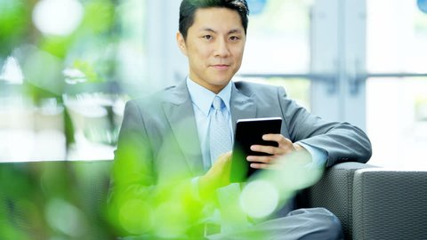 portrait US Asian business businessman young manager indoors advertising office client contacts touch screen cloud technology RED DRAGON