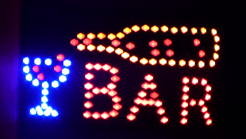 A colorful flashing bar sign.