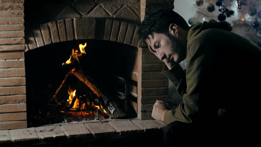 Depressed, sad man in front of a fireplace | Shutterstock HD Video #14600788