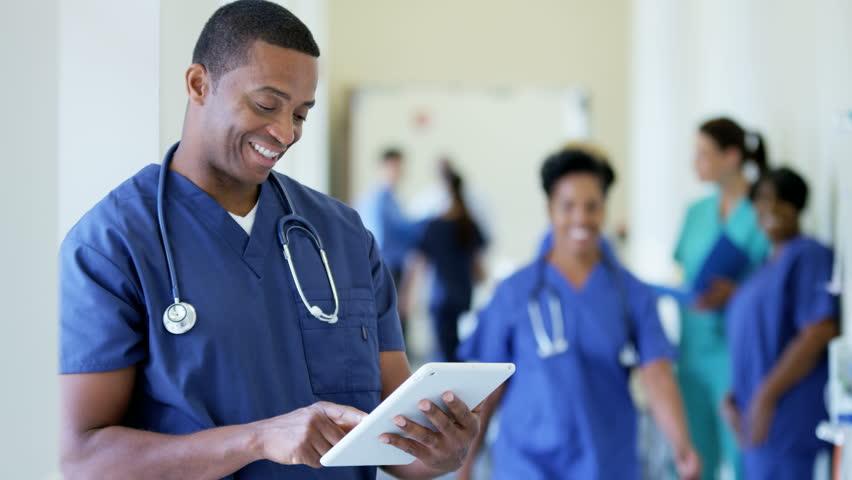 African American Female Senior Nurse Working On Technology -5205