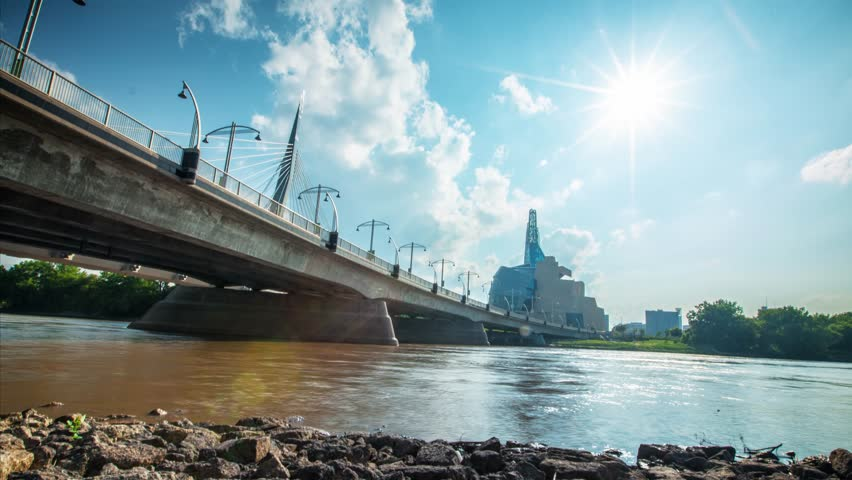 Breathtaking time lapse pan by Winnipeg's Provencher Bridge with the Canadian Museum of Human Rights in the background in 4K