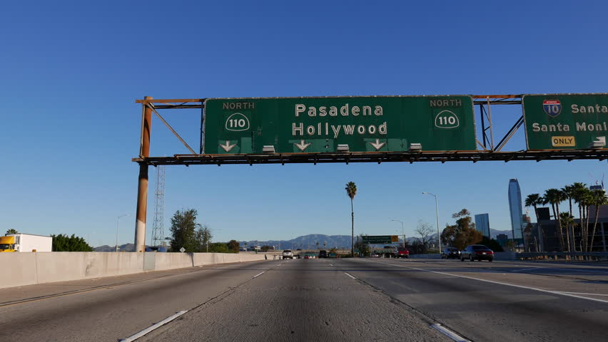 LOS ANGELES, CALIFORNIA, USA - February 7, 2016:  Pasadena and Hollywood 110 freeway sign in downtown Los Angeles.   Shutterstock HD Video #14619238