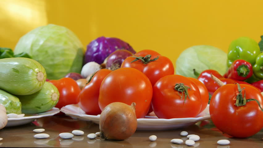 Long and slowly dolly shot of seasonal vegetables arranged in plate on the table,tracking,close up,similar clip also in 24 and 30 fps,no color grading,interior. | Shutterstock HD Video #14651074