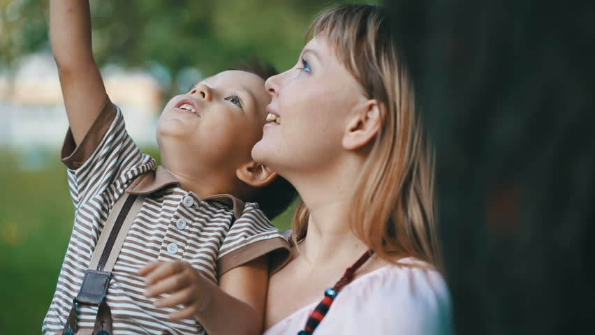 Mother With a Child Look at the sky   Shutterstock HD Video #14679454
