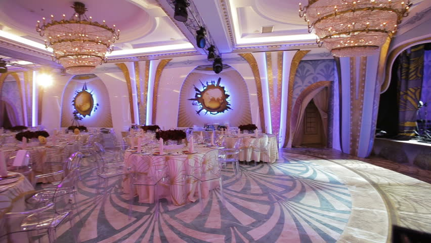 Stock Footage of Interior of a wedding hall decoration ready for guests.Beautiful room for ceremonies and weddings.Wedding concept.Luxury stylish wedding recept