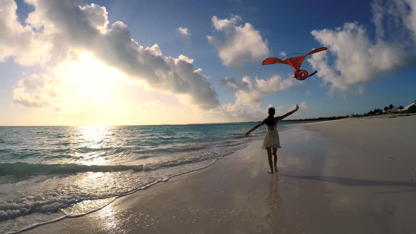 Young ethnic Asian Chinese girl with red kite on the beach at sunrise | Shutterstock HD Video #14688568