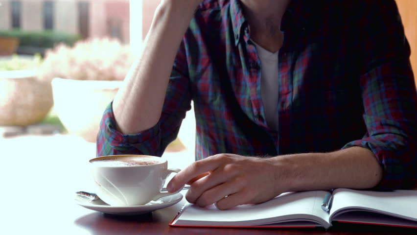 Student talking on his phone while on his break | Shutterstock HD Video #14690548