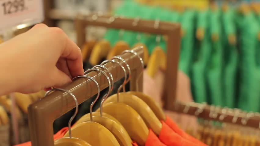 Girl goes through a coat hanger. | Shutterstock HD Video #14693458