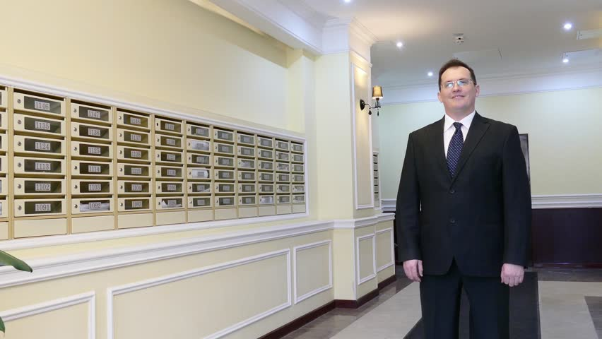 Apartment Building Mailboxes apartment concierge: man on mailboxes background stock footage