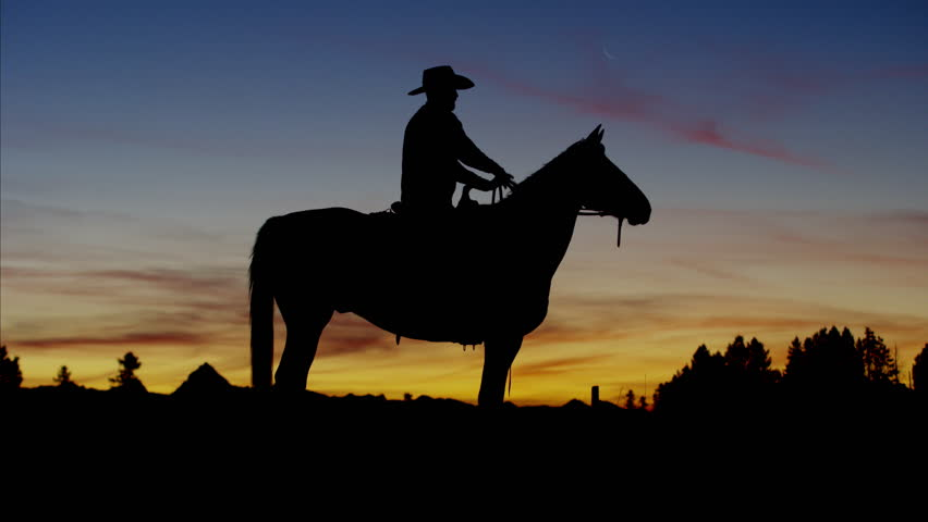 Silhouette of Cowboy Rider at sunset Wild West area Canada #14712718