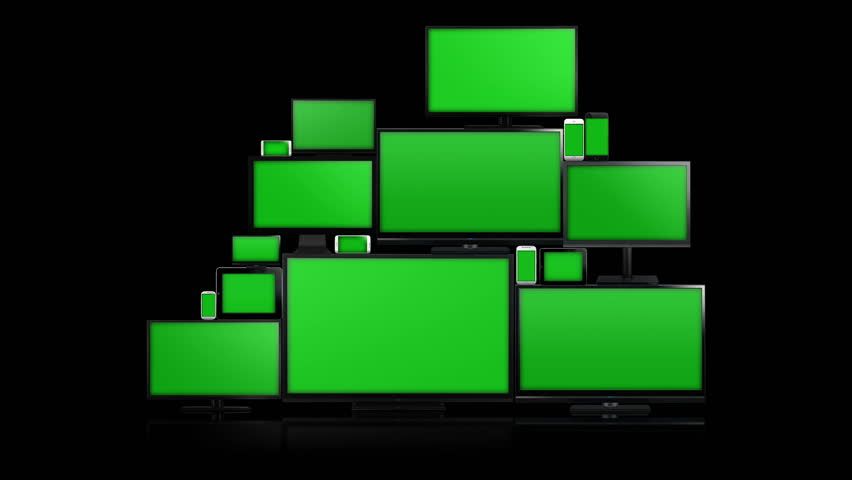Many different types of screens. TVs, computer monitors, smartphones and tablets. They laid on each other in a pile isolated on a white background. They are all with a green screen. Zoom in & alpha.
