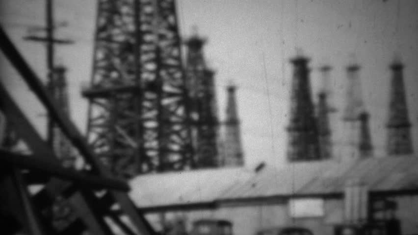 LONG BEACH, CALIFORNIA 1938: California oil drilling fields steel derrick tower rigging. | Shutterstock HD Video #14728525