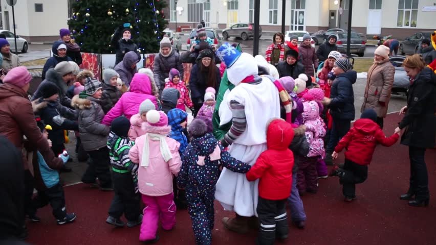 MOSCOW - DECEMBER, 18: Children stand around and repeat movement for Christmas tree in center in housing complex Losinyj Ostrov. At meeting of New Year people are going to close for New Year table.