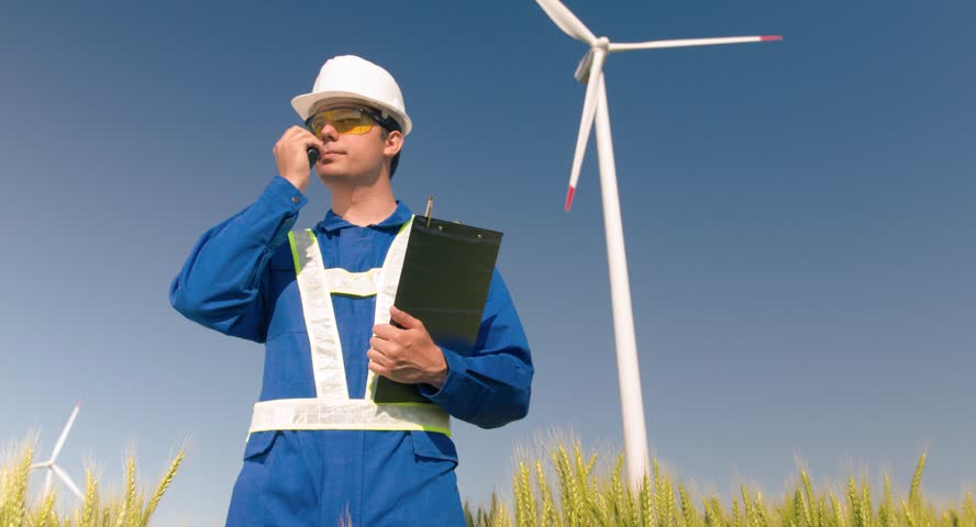 Supervisor Working Talking Walkie-Talkie Agriculture Windmill Communication Protective Uniform Renewable Energy Windpower Development Sustainability Engineering