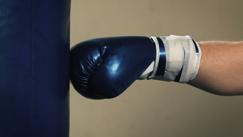 Hand Of Boxer And Punching Bag