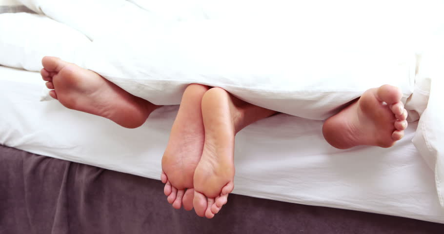 Couple Feet Sticking Out From Stock Footage Video 100 -7111
