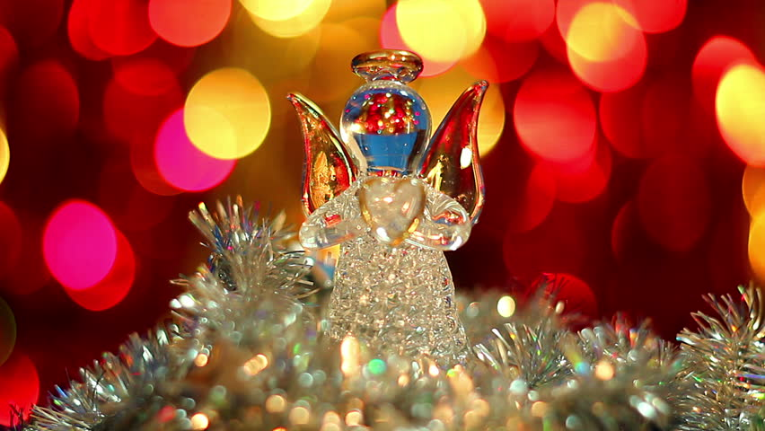 christmas toy, angels toy, Sitting angel on the christmas background, Toy Christmas angels decorations hiding in artificial branches, Two Christmas angels ...