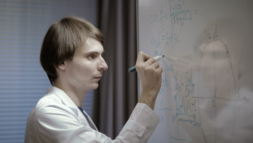 Male scientist writing various high school maths and science formula on whiteboard | Shutterstock HD Video #14810002