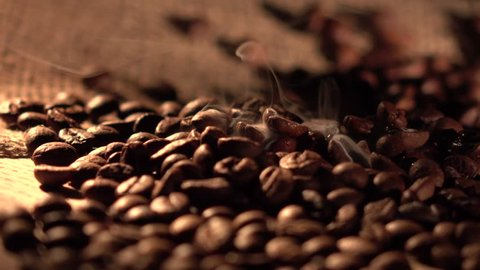Coffee beans with star anise on barrel, cam moves to the right, close up