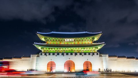 Time lapse of Gyeongbokgung palace and traffic at night in Seoul,South korea. 4K.