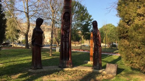 Statues with trees.
