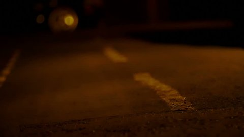 detail of feet of man running alone in the street during the night