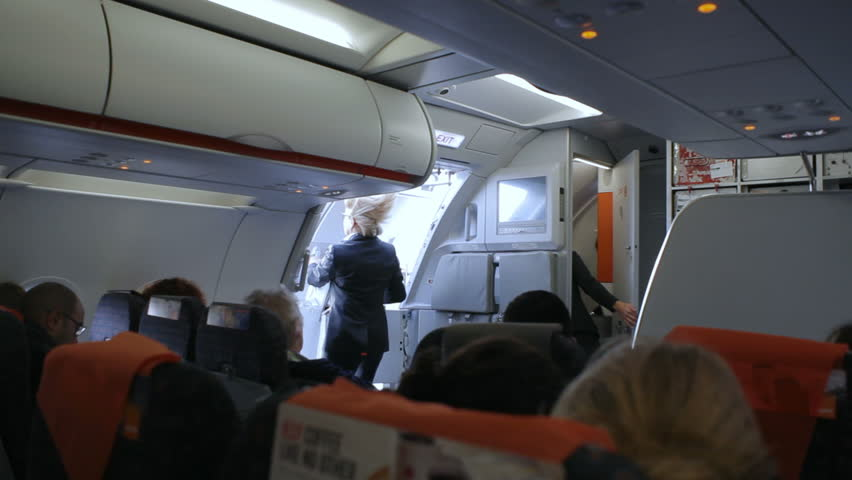 GERMANY - CIRCA DECEMBER 2015 - Flight attendant steward closes airplane door before takeoff & Airplane Door Stock Footage Video | Shutterstock Pezcame.Com