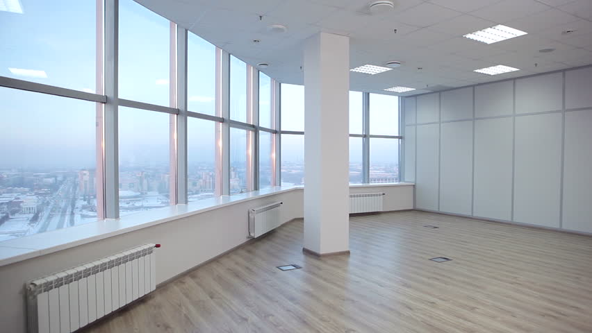 large office space. Service Employee Enters Into An Empty Office And Examines Him. Spacious With Large, Large Space