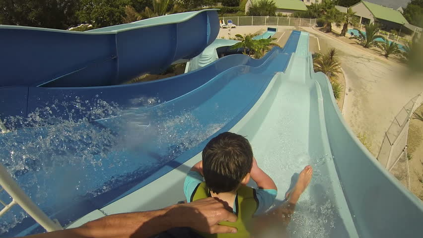 Daddy And Son Going Down An Outdoor Water Slide In the Summer #14875468