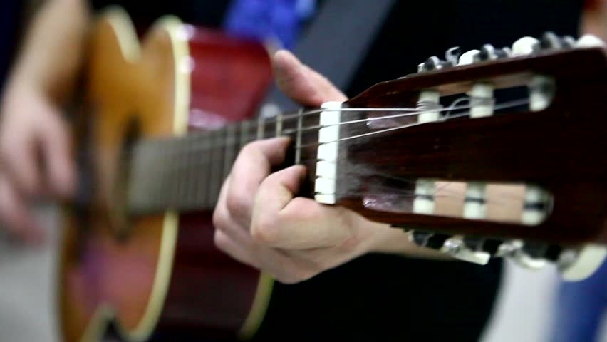 Stock Video Clip Of Man Playing Guitar Close Up Transposes Chords