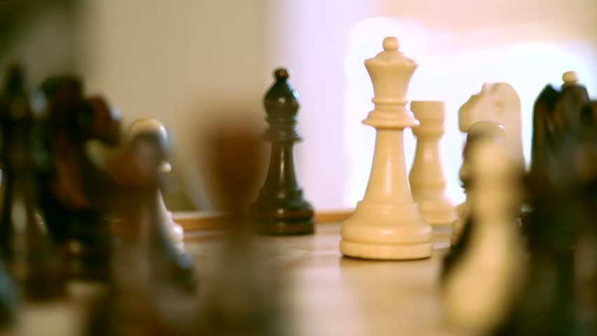 The white queen takes a black castle in the game of chess.