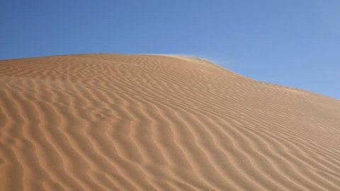 SAHARA DESERT,  TUNISIA - CIRCA OCTOBER 2015:  time lapse:  the beautiful effect of the wind on a dune in the desert.