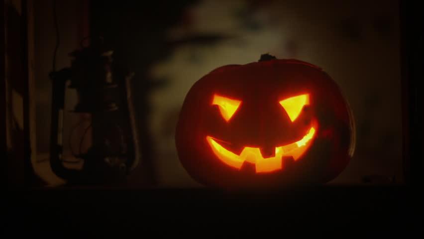 a scary halloween pumpkin lantern in the window seamless loop clip id halloween12n - Halloween Background Video