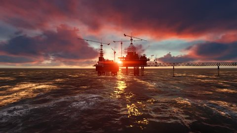 Oil Rig in Ocean at sunset