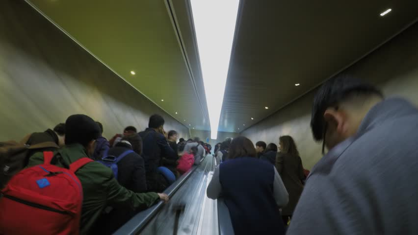 SHANGHAI - NOV 05, 2015: Many people movement on escalator and tunnel. Timelapse #14990158