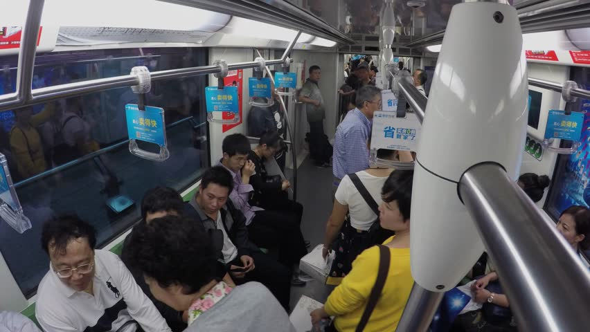 SHANGHAI - NOV 07, 2015: Many people ride in metro train by tunnel with commercial banners. Timelapse | Shutterstock HD Video #14990548