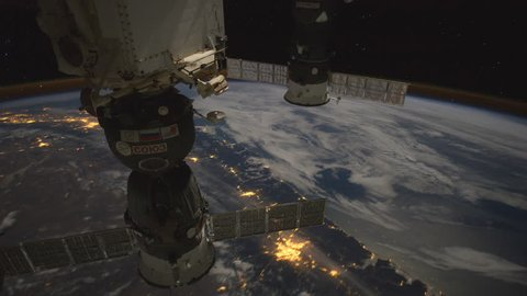 International Space Station over Earth. Moonglow over Canada and Northern U.S. The footage was created with images from Nasa Expeditions that have been changed and composed into a time lapse