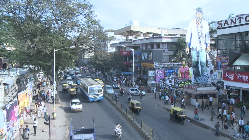 INDIA - CIRCA NOV 2008: Time lapse view of traffic and pedestrians traveling down a busy street circa Nov 2008 in India.