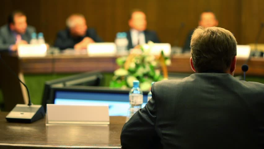 Man in business suit sit at the table on conference