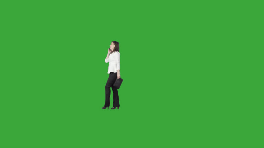 Elegant young lady in business suit with clutch professional skilled expert talks on cell phone & roams. Green screen clip. File format - .mov, codec PNG+Alpha. Shutter angle -180 (native motion blur)