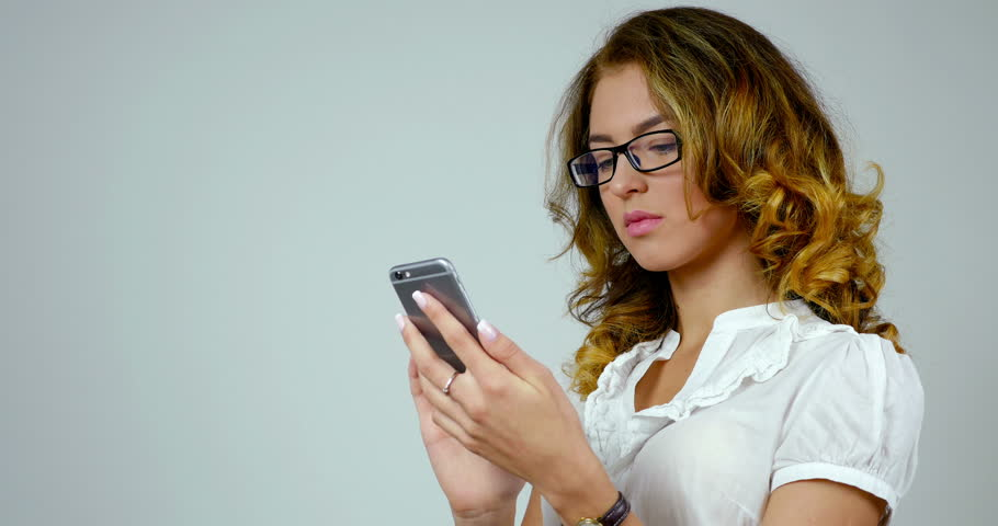 Close-up portrait of a businness woman uses smartphone
