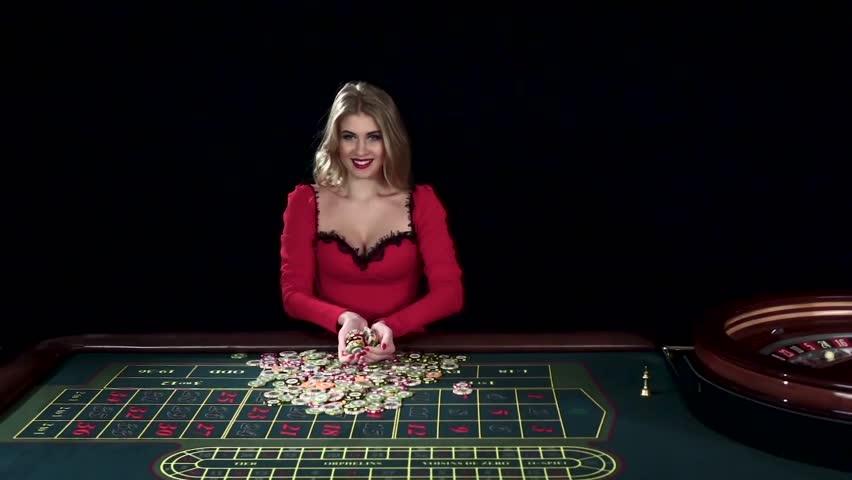 Winning woman tossing up chips. Black. Slow motion | Shutterstock HD Video #15135568