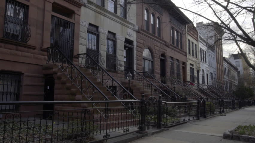 A dolly shot of Brownstone homes in Brooklyn, NY
